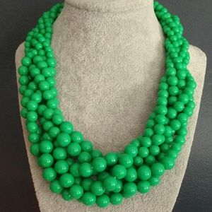 Kelly green graduated round bead twisted necklace